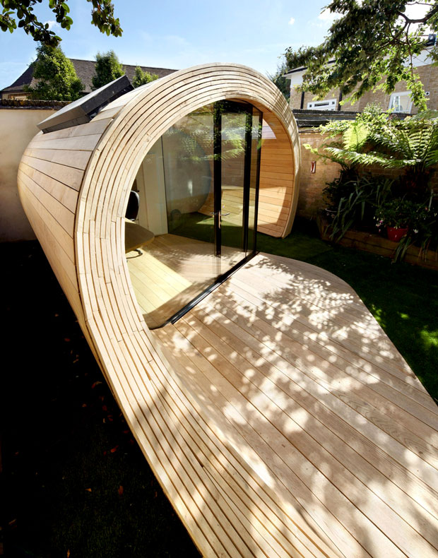 small-unique-modern-storage-shed-office-in-the-backyard-garden-ideas-with-glass-sliding-door-and-half-tube-design-plus-wooden-ceiling-floor-and-wall